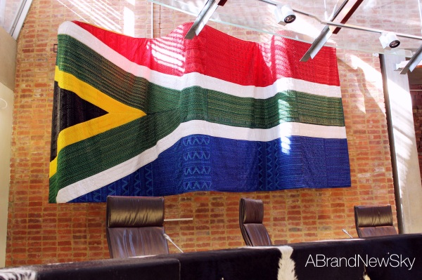 The glorious South African flag, hanging on the  bricks of the old awaiting trial block of the prison
