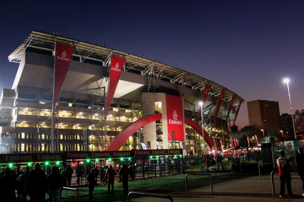 The entrance to the stadium, all draped in red